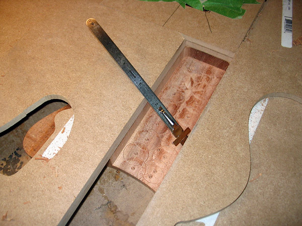 Carve-out the pocket using a template and a router