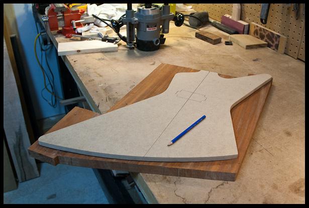 Tracing the body shape on the mahogany body