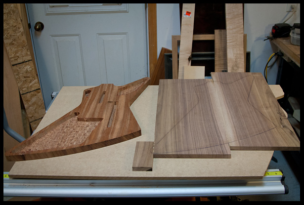 The top walnut blank next to the mahogany back
