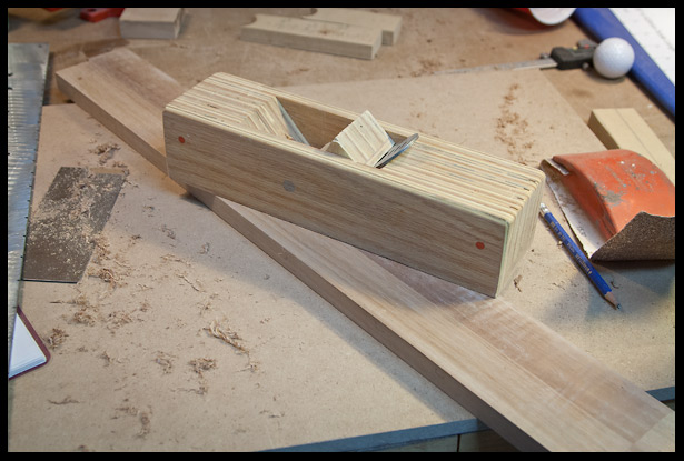planing the neck surface flat. This is where the fingerboard will sit.