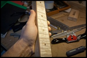 sanded the fretboard to 320 grit followed by steel wool