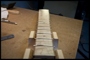 The fretboard with frets installed