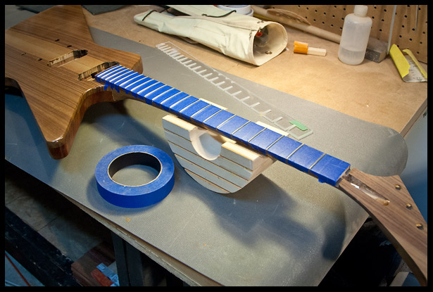 Protecting the fretboard with painter's tape