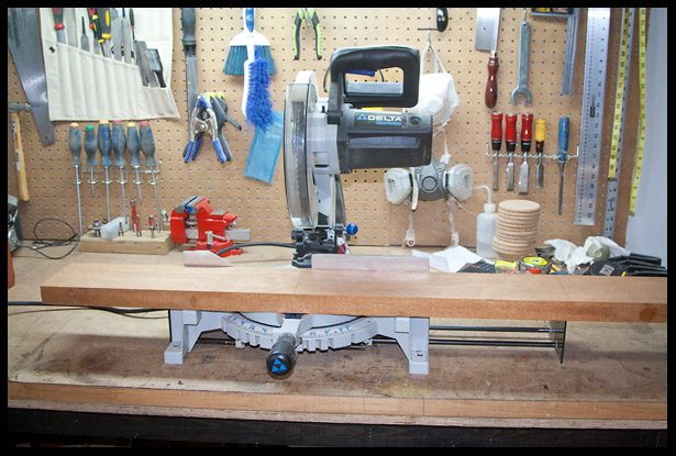 Cutting the mahogany into 3 pieces on the miter saw