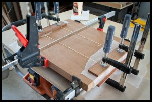 Gluing the mahogany pieces
