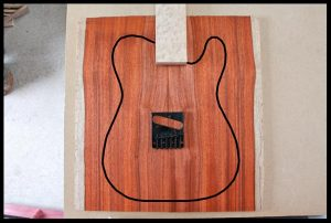 All-red top with bird's eye maple fretboard