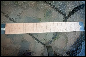 All the fret slots are cut