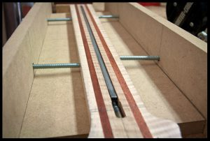 Truss rod in channel