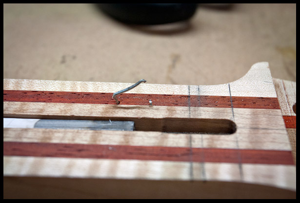 Locator pin for fretboard placement