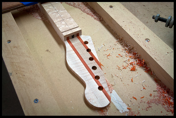 Reducing the thickness of the headstock