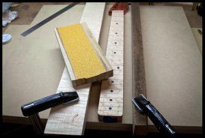 Tape some 60 grit sandpaper to the radiusing block