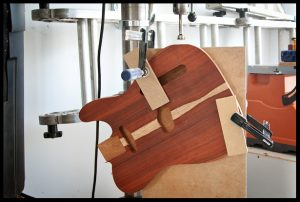Clamped on the drill press to drill the jack hole