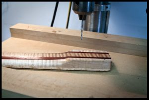 drilling the holes on the neck heel