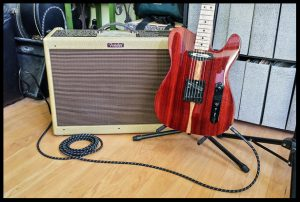 Testing the guitar on a Fender Blues Deluxe Reverb