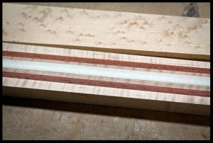 Place masking tape over the truss rod channel