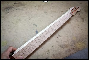 The fretboard is glued on