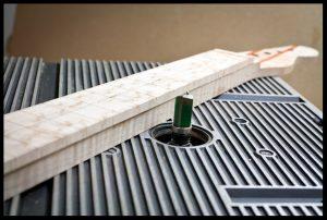 Flush trim the fretboard