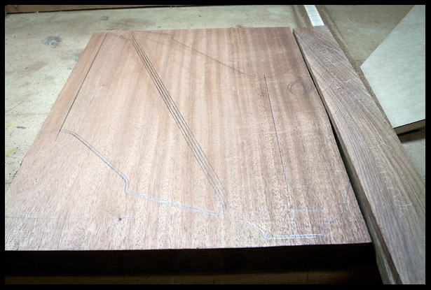 Tracing the body shape on the mahogany board