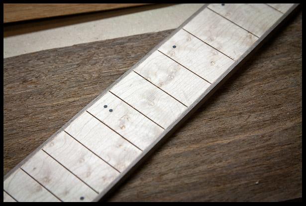 Birdseye fretboard with binding and dot inlays