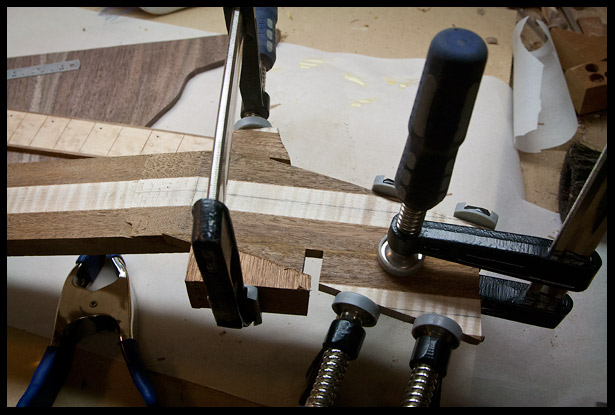 After the scarf joint is glued, I add extra pieces to the headstock