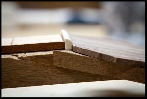 Putting an angle on the edge of the headstock veneer
