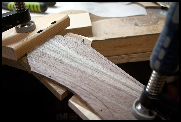 Placing the headstock veneer in position with a few finishing nails