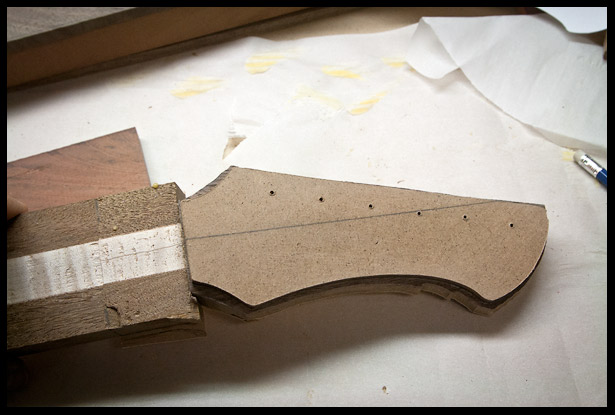 Trimming the headstock according to the template