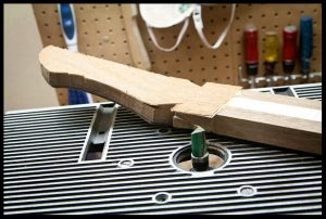 Routing the headstock according to the template