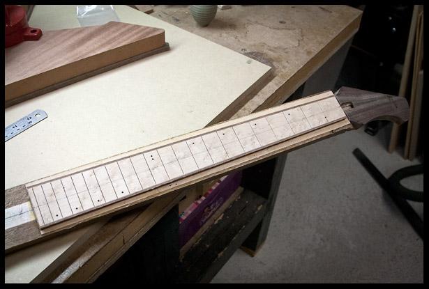 Fretboard glues onto neck