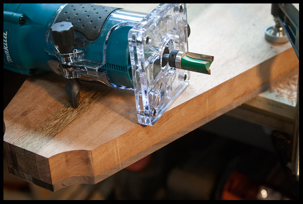 The walnut, which was slightly oversized is trimed using a trim router and a bit with a ball bearing.