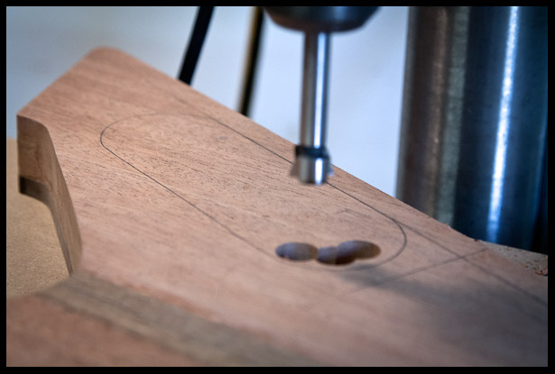 Drilling away most of the wood for the electronics compartment