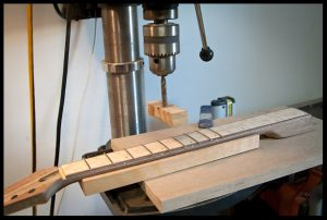 Pressing the frets