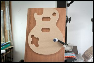 Sizing the mahogany with the template