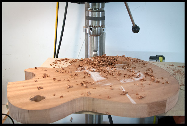 Drilling most of the wood from the electronics cavity