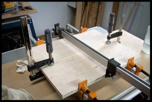 Gluing and clamping the book-matched set