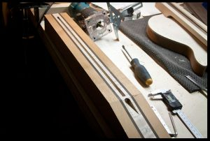Truss rod channel and access cavity are carved