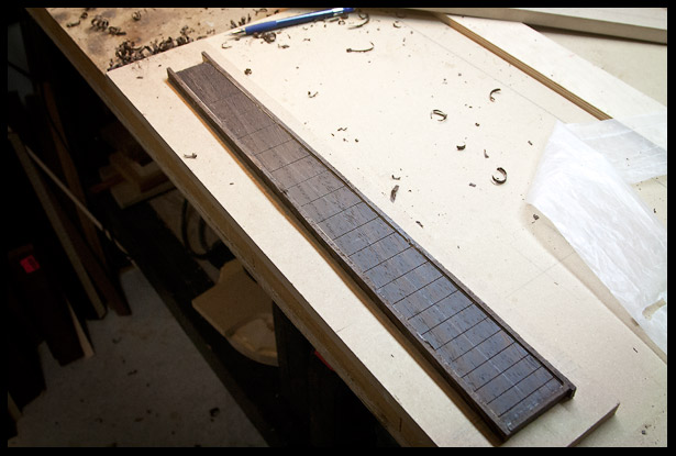 The fretboard is bound, needs some cleaning up