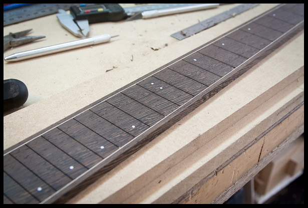 Fret markers are added