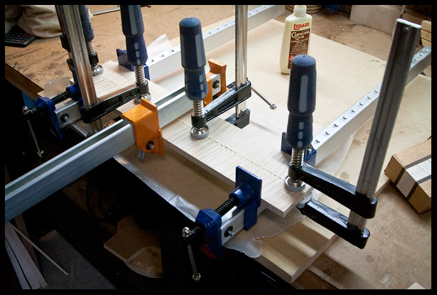 Gluing and clamping maple to make the headstock veneer