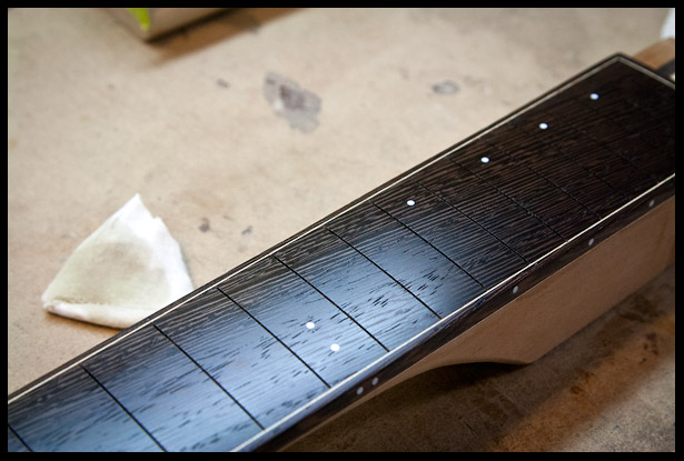 Wenge fretboard sanded with oil