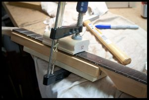 Clamping the frets