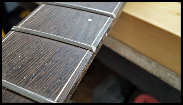 fret ends beveled to 35 degrees